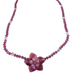 Price :$42.50 Fuchsia & Clear Swarovski Crystals Flower Pendant Handmade Jewelry Material Used : Swarovski Fuchsia Crystals 4mm bicone & 6mm bicone clear Crystals Necklace Length : 16 inches with extension 2 inches Earrings : Can customize in 92.5 Hook with mix beads of Swarovski clear & fuchsia approximate measures 1 to 1 1/2 inches long