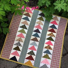 Love playing with your scraps? If you're following along in my online small quilt groups, we're making this flying geese doll quilt from my book Small & Scrappy as our Challenge for May. #smallquilts #kathleentracy #dollquilt #smallandscrappy