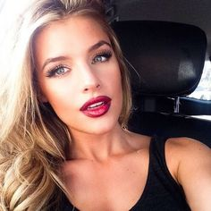 Red lips with an even darker red lip liner