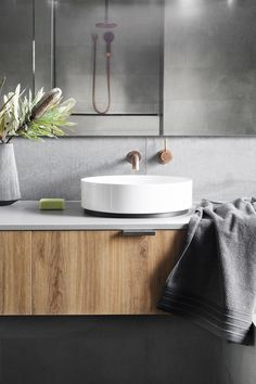 Concrete-look tiles and tapware from Astra Walker create a sleek and stylish bathroom in this energy efficient Melbourne home. Bathroom Spa, Bathroom Renos, Laundry In Bathroom, Bathroom Interior, Modern Bathroom, Bathroom Vanities, White Bathrooms, Luxury Bathrooms, Master Bathrooms