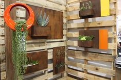 love the use of old pallets and bright color to add a little dimension to this outdoor entrance