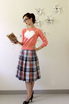 plaid skirt + pumps + crew neck sweater | like the vintage librarian look. i'd pair it with booties or flats or oxfords. probably a v neck sweater over a crew neck.