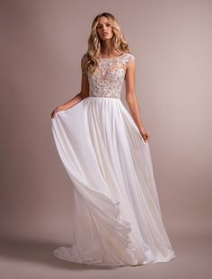 Style 6911 Hemmingway Hayley Paige bridal gown - Ivory chiffon A-line gown, beaded and embroidered cap sleeve bodice, jewel neckline front and back with cashmere sweetheart lining, flowing chiffon A-line skirt.