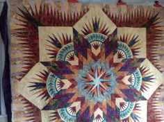 You can tell that LOTS and LOTS of hours went into this Prairie Star quilt Corey created for a customer. Amazing work!