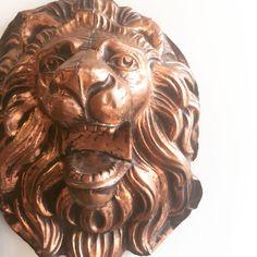 Copper lion's head from the famous St. Louis Hotel, New Orleans, LA