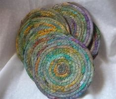 Use Up Scraps in Coiled Coasters, Trivets and More - Quilting Digest - Daria Quilted Coasters, Cool Coasters, Fabric Coasters, Sewing Crafts, Sewing Projects, Coaster Crafts, Fabric Bowls, Rope Crafts, Textiles