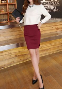 This burgundy pencil skirt features a comfy elastic waist and a fashionable front slit. | Lookbook Store Office Style