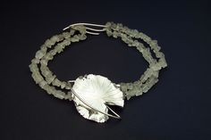 Water Lily on Quartz Crystal necklace, sterling silver. Copyright Robyn Nichols