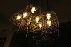 Cage lamp chandelier for Pillar of Rock Bolsover (J D Wetherspoon) Interior design: Architect CT