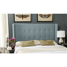 This handsomely tailored queen headboard is artfully upholstered in denim blue fabric tightly fitted across its low-slung silhouette. Boasting contemporary straight-lined wings, this striking uncomplicated design complements contemporary bedrooms in style.