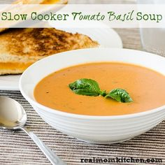Slow Cooker Tomato Basil Soup Recipe Soups with diced tomatoes, chopped celery, minced onion, carrots, chicken broth, flour, grated parmesan cheese, butter, half & half, salt, pepper, dried oregano, fresh basil