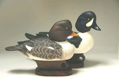 - Barrow's Goldeneye couple - male carved in white cedar and hollowed out - female carved in red cedar and hollowed out - Balanced keel in Ipe wood - acrylic paint - Female winner  of  first 1st Place Show category novice in the Montreal Hunting and Fishing Show 2009 - male winner in the second place ducks divers , Montreal Hunting and Fishing Show 2009 .