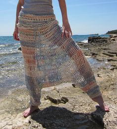 Crochet harem pants overall in pastel colors, aquamarine, green, blue, salmon, cream in cotton. $240,00, via Etsy.