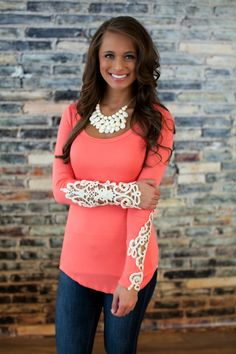 The Pink Lily Boutique - All I Need Lace Sleeve Blouse Coral, $35.00 (http://thepinklilyboutique.com/copy-of-all-i-need-lace-sleeve-blouse-mint/)
