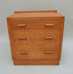 s5545 An oak chest of drawers by Bowman Brothers of Camen, circa 1930  74cm (29in) high, 72cm (128.5in) wide, 43cm (17in) deep Ticket £875