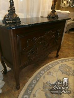 Black and white marble topped chest with two carved front drawers. Measures 46*18*32.