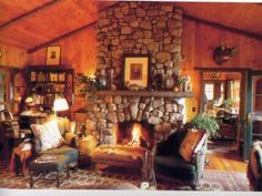 Cabin living room with a rockwall fireplace!