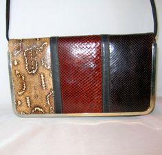 Vintage Three Color Snakeskin Purse Clutch Shoulder Bag 1980. $27.00, via Etsy.
