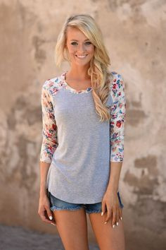 This adorable top is perfect to transition to fall. True to size. Model is 5'5'' wearing a small. Material: 95% Rayon 5% Spandex Product Sizing Chart Size Bust Hip Length Waist Small 36 N/A 26 N/A Med