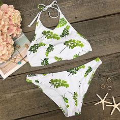 High quality, stylish and unique beach style, there is no doubt this halter printing bikini is the hottest piece for spending a cool summer vacation around the seashore. You'll sure make a roaring statement!