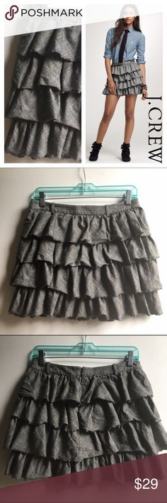 "J. Crew Tiered Ruffle Skirt, 2 J.Crew wool blend tiered mini skirt. Size 2. This light weight wool skirt is made of a subtle plaid design in shades of beige, gray, black and light blue. It zips up the back and is made of four raw edged tiers. It's fully lined. Fiber content/care tag has been removed. Approximate Measurements: 15"" flat across waist, 15"" long. Fabric content: Shell: 98% wool 2% other fibers Lining: 100% acetate.   Dry Clean. J. Crew Skirts Mini"