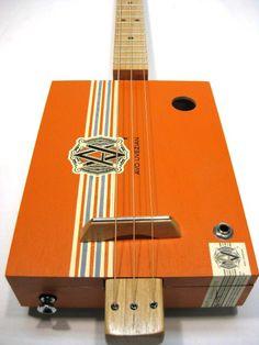 Avo Uvezian Cigar Box Guitar [1092] Snowden Guitars   This cigar box guitar is made with a Avo Uvezian Toro cigar box. The cigar box measures 9.5 x 7 x 2 inches.