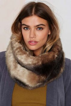 This faux fur's neck and neck with the real thing.