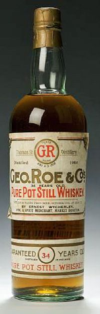 An old bottle of George Roe Irish whiskey distilled in 1904 and bottled in 1938