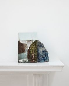 Stuart Whipps, A postcard of Victoria Falls leaning against a geological sample from John Latham's mantlepiece (2012)