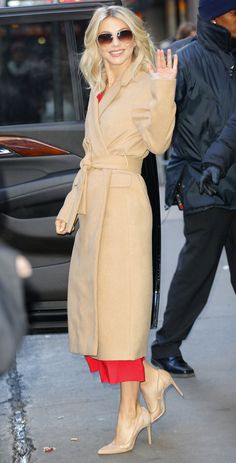 Julianne Hough in a camel Topshop trench coat, red dress and nude heels.
