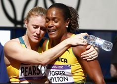 Australia's Sally Pearson (L) consoles Jamaica's Brigitte Foster-Hylton after she failed to advance from her round 1 women's 100m hurdles heat during the London 2012 Olympic Games at the Olympic Stadium August 6, 2012.