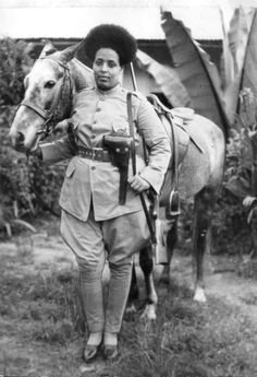 A female soldier of the Ethiopian Irregular Forces poses for a photograph. Having been invaded by Benito Mussolini's fascist Italy in October 1935