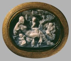 Onyx Cameo of a Sleeping Hermaphroditus Surrounded by Cupids From Egypt, circa 1st century BC, the workshop of Sostratos in Alexandria.Hermaphroditus was the son of Aphrodite and Hermes. According to Ovid, born a remarkably handsome boy, he was transformed into an androgynous being by union with the water nymph Salmacis. Hermaphroditus had long been a symbol of androgyny or effeminacy, and was portrayed in Greco-Roman art as a female figure with male genitals.