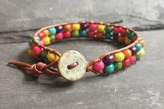 Leather bracelet with rainbow wooden beads and button fastener, Pride Wrap Bracelets, Colorful Bracelets, Beaded Bracelets, Leather Cord, Brown Leather, Organza Gift Bags, Fasteners, Wooden Beads, Rainbow Colors