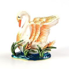 """#Swan In Pond Keepsake Box Item No. KB00443A01 $33.59 This beautiful swan with its wings spread, about to take flight from the pond, would look great in any bathroom. It would also be useful for holding jewelry or other small items. It is made from pewter and built to last. Decorated with Austrian crystals for the perfect amount of sparkle."""" Red Robin Bird, Golden Frog, Ribbon Box, Beautiful Swan, Orange Crystals, Bird On Branch, Jewel Box, Horse Head, Keepsake Boxes"""