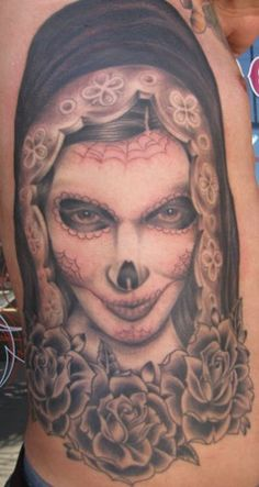 day of the dead tattoo, I'm thinking of this but with the blue veil of our lady of guadalupe