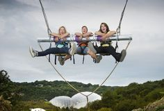 Three people on Giant Swing Eden Project