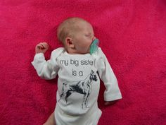 My Big Sister is a Boxer  Dog baby clothes for your baby girl or baby boy. These cute baby clothes feature a Boxer with the text My Big Sister Is and
