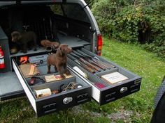 Hunting preparedness kit built into a truck. I need this, including the 2 chocolate lab puppies! Hunting made simple Ammo Storage, Vehicle Storage, Truck Storage, Hidden Storage, Vw Camping, Outdoor Camping, Hunting Gear, Crossbow Hunting, Hunting Stuff