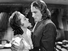 Olivia de Havilland and Errol Flynn in Captain Blood directed by Michael Curtiz, 1935 Errol Flynn, Golden Age Of Hollywood, Classic Hollywood, Old Hollywood, Divas, Captain Blood, The Blues Brothers, Chick Flicks, Actrices Hollywood