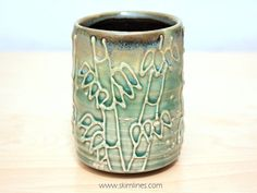 This is a cup that I've made. It's a bamboo forest done in slip trail ♧ http:// www.etsy.com/listing/223336615/glossy-green-celadon-and-matte-black