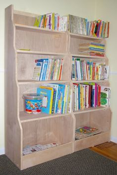About Project    These bookcases are cute and extremely functional. I love the bottom bins. Even as young as three years old, your child could fill these bins with toys when instructed. Give your child a chance to be organized with the Banker's Bookcases.