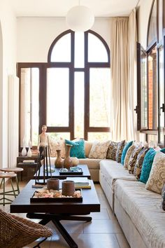 I really love the accents here! Especially the teal pillows on a palate of neutrals!