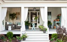 This Southern-inspired porch featuring #Trex Transcend in Gravel Path creates a relaxing outdoor living space.