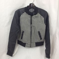 ♠️♥️Black & Grey Checkered Jacket w/Faux Leather Very Cute Black and Grey Checkered Wool Jacket with Faux Leather Sleeves - Zipper Closure , IS A SIZE LARGE, BUT FITS A US WOMEN'S SIZE SMALL. New W/O Tags!  Measurements : Shoulder to Hem 21in, Sleeves Shoulder to Wrist 25 1/2in. Boots sold Separately, but we can offer as a bundle deal, just ask. Fast Shipper!  Jackets & Coats