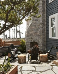 Black adirondack chairs. Sawed off tree stumps to use as tables or extra seating.