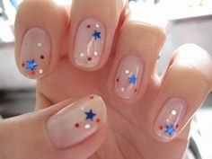 4th of July nails. Sheer nude nails with patriotic stars. I've done mine differently, but you may like this, Kayla!