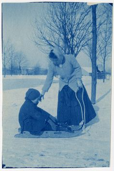 Louis Yott, a student who is deafblind, is seated on a sled. His teacher, Mrs. Sagar, is touching his face and holding the lead rope. At the Kindergarten for the Blind in Jamaica Plain, MA. Visit the Perkins Archives Flicker page: http://www.flickr.com/photos/perkinsarchive/collections/