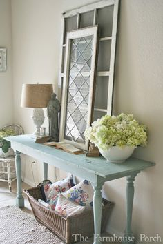 Love the antique windows on the table and the vintage linens too!