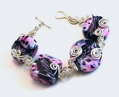 Hot Pink animal print wire wrapped lampwork by ToBeUniqueJewelrys, $59.99